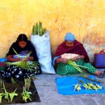 Ladies making Palm Sunday crosses to sell on Easter Sunday.